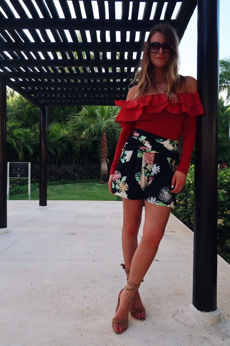 life with aco, vacation outfit, red ruffle top, floral shorts outfit