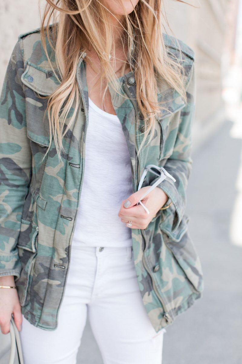 1 person, all white outfit, camo jacket