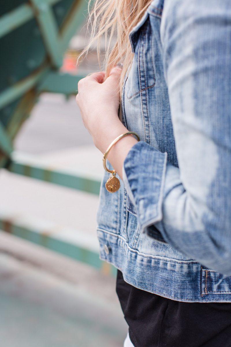 close up shot of bracelet, charm bangle on wrist