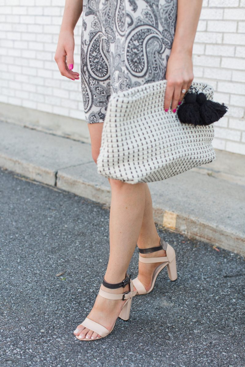 1 person, girl wearing block heel sandals and fabric clutch