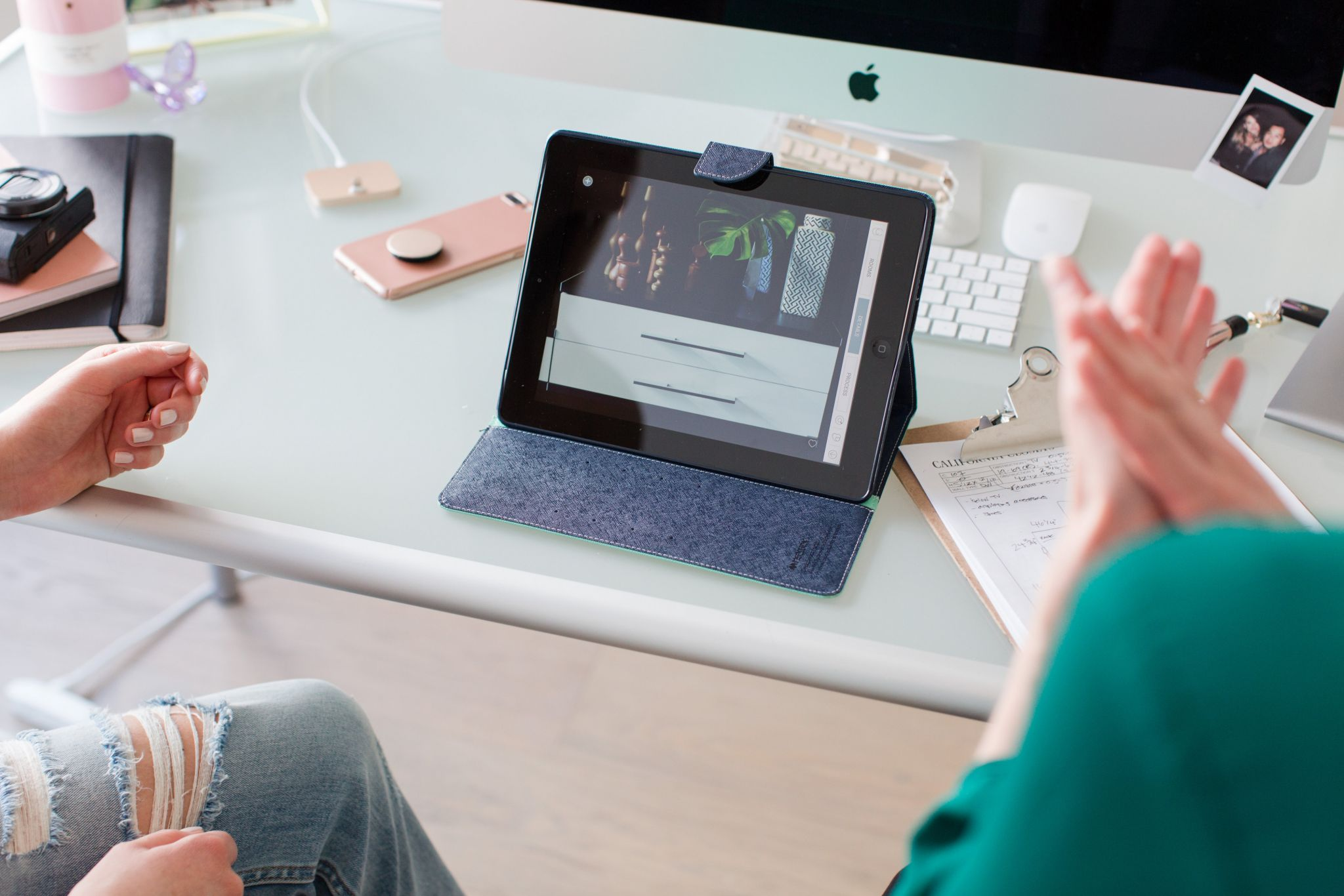 California closets design consultation, iPad with closet photo on screen