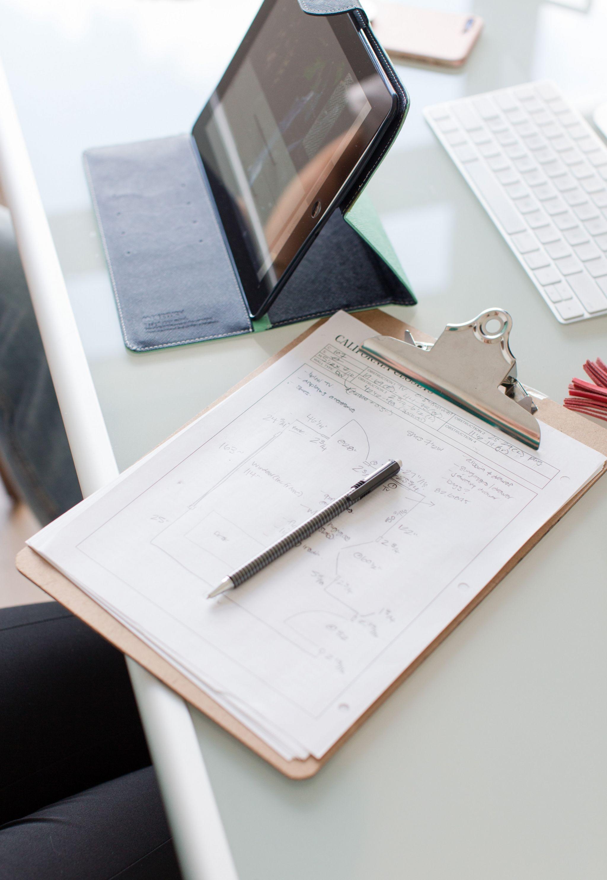 clipboard on desk, California closets design mock up