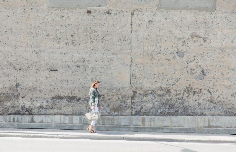 1 person, fashion blogger, camo jacket and big wall