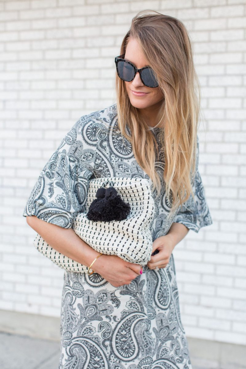 1 person, girl wearing paisley dress, grey sunglasses