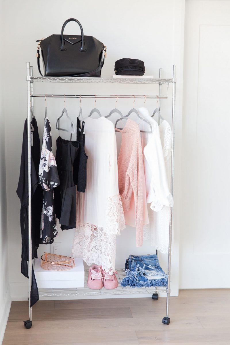 1 rolling rack, styled with clothing