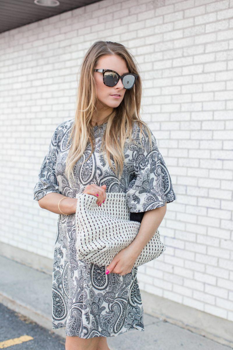 1 person, girl wearing paisley dress, quay sunglasses