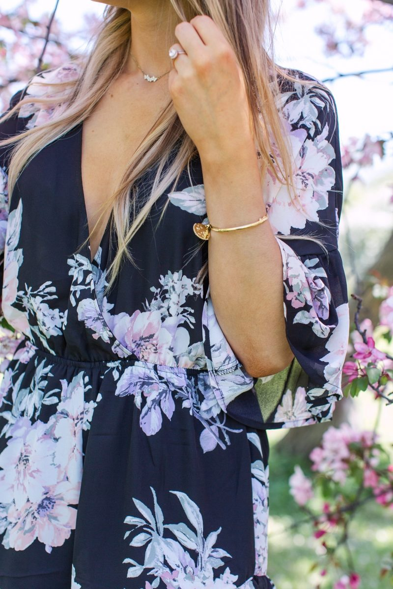 1 person, floral romper and gold braclet