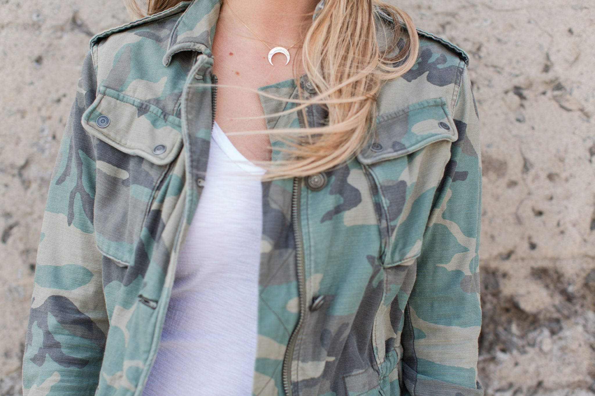 1 person, horn necklace, camo jacket