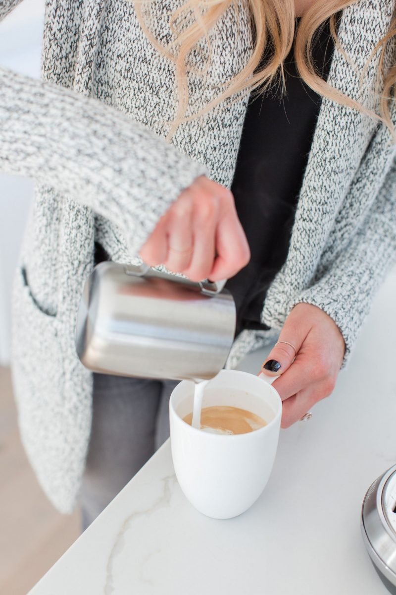 1 person pouring milk into coffee, latte art
