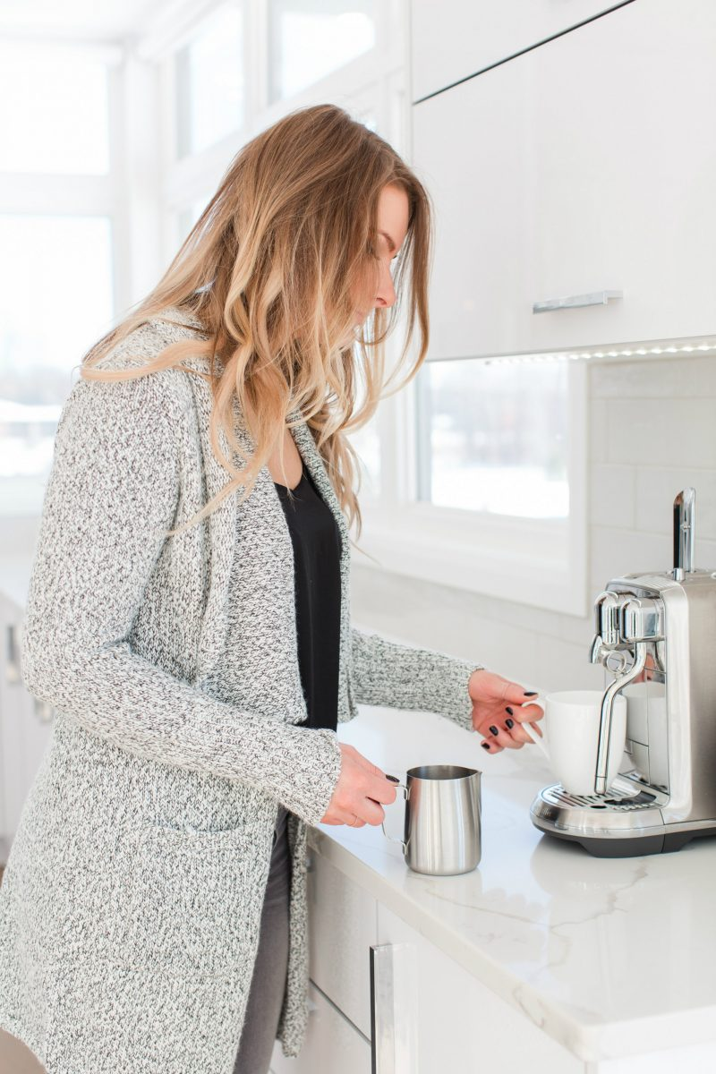 1 person, making coffee with Nespresso machine