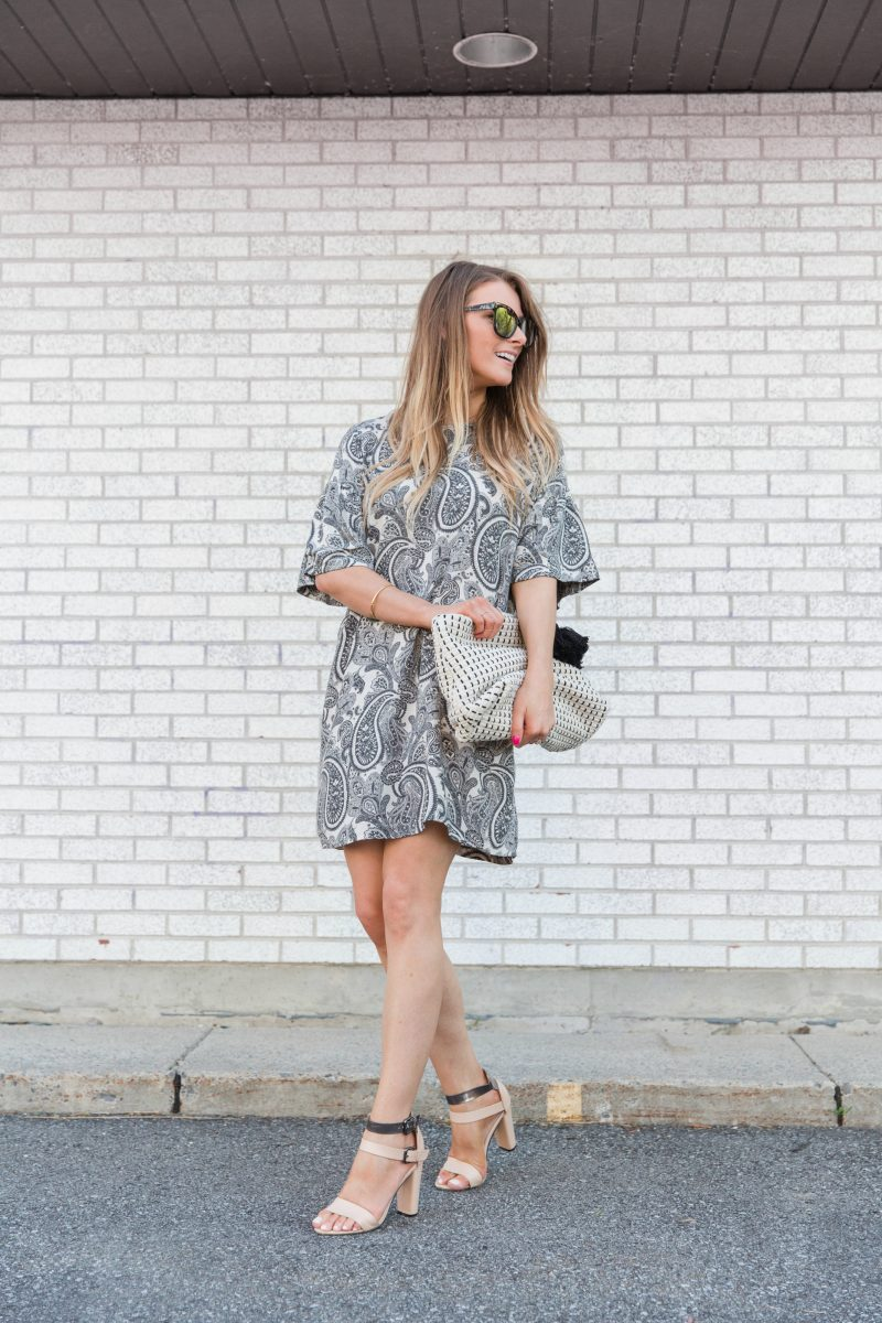 1 person, girl wearing paisley dress and oversized clutch