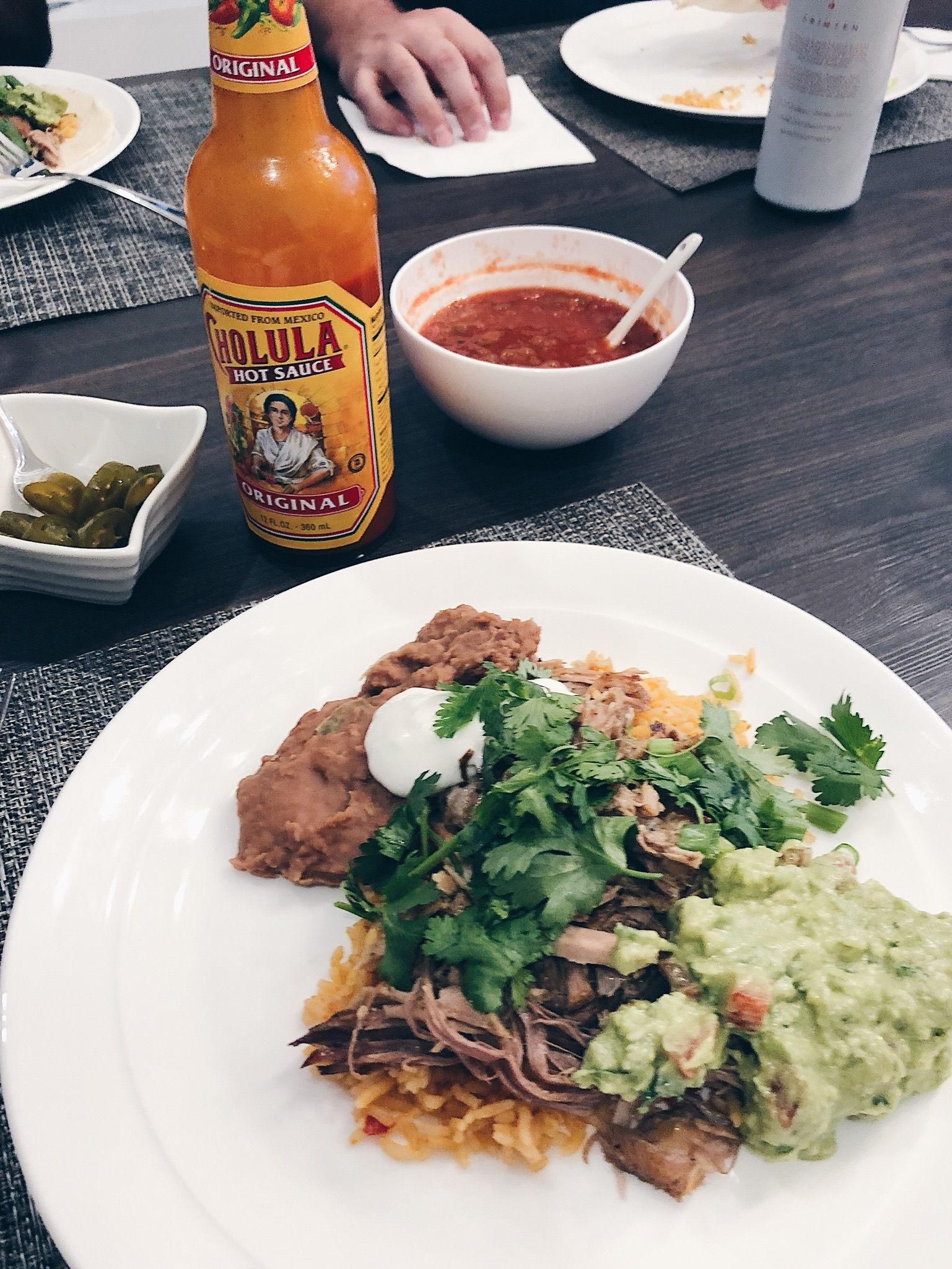 taco night at a table, hot sauce