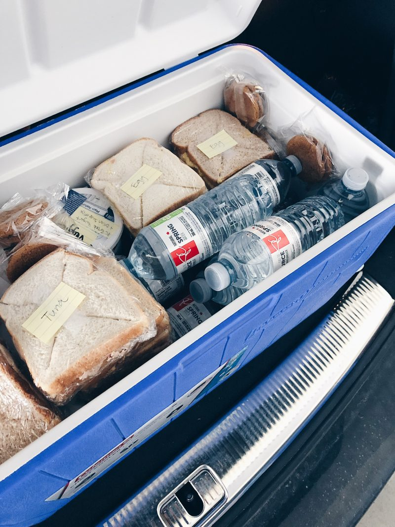 cooler of sandwiches and water, wedding party food