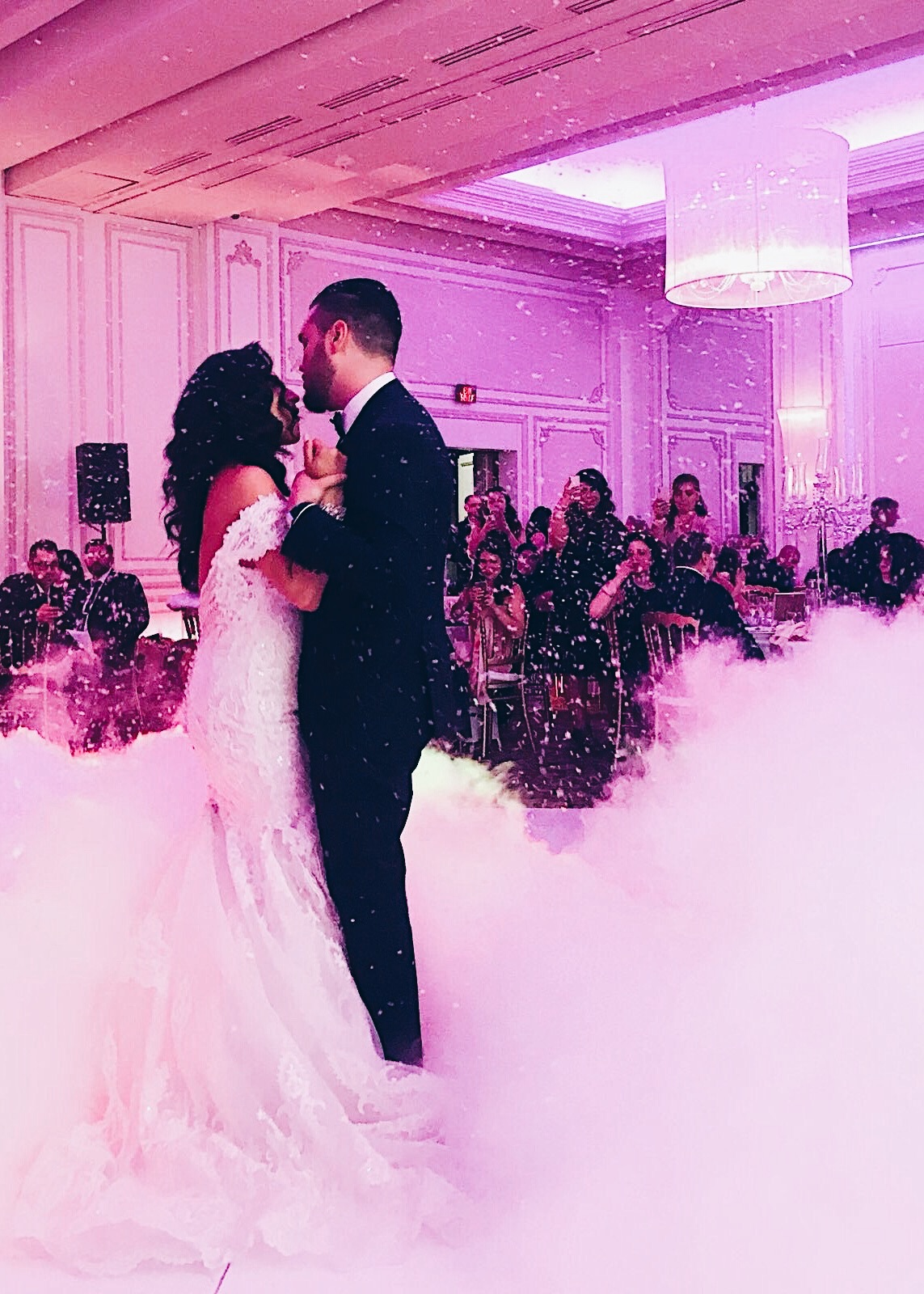 two people dancing at their wedding, Lebanese wedding dance, smoke machine dance floor