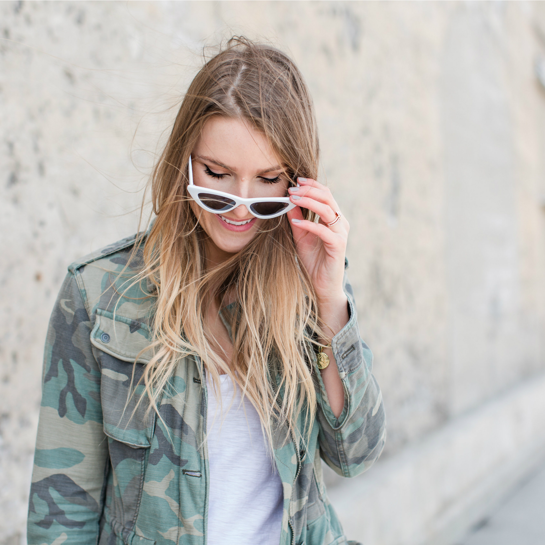 1 person, blogger girl wearing camo jacket, white cat eye sunglasses retro