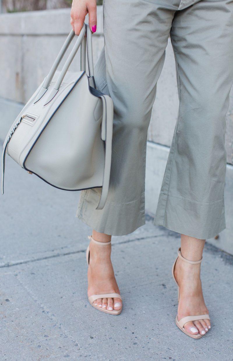 1 person walking, hips down, Celine phantom in grey