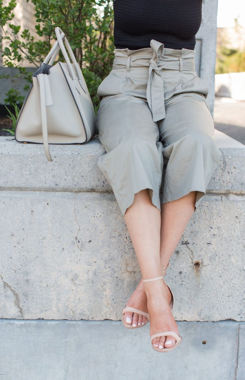 1 person sitting, culotte pants and Celine bag