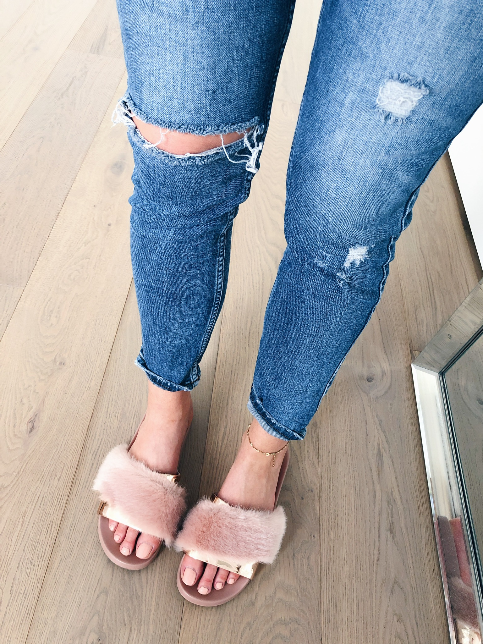 1 person, from where I stand, fur slides and jeans