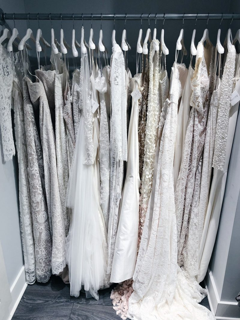 white satin bridal showroom, white satin bridal Ottawa wedding dresses on racks