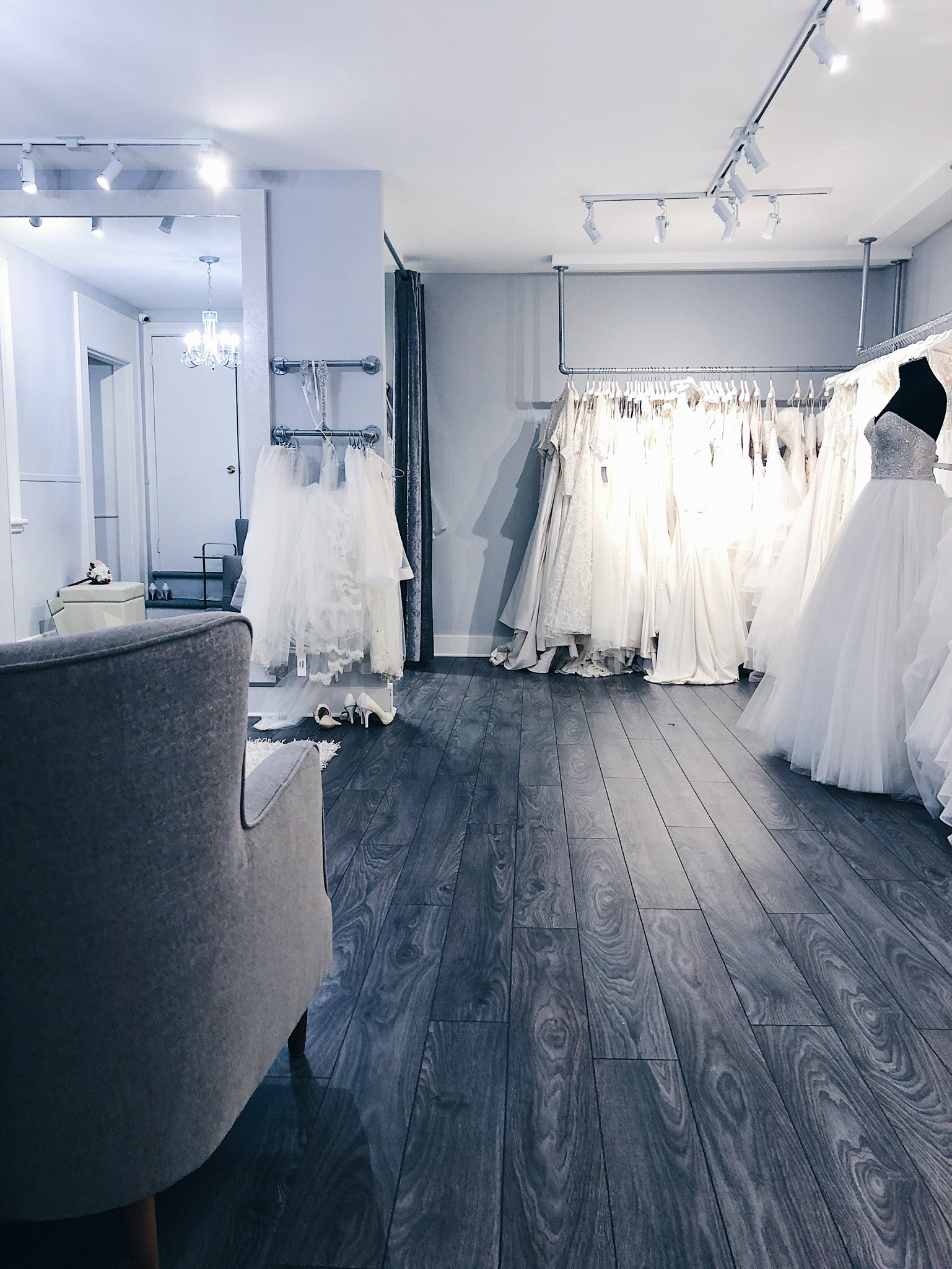 white satin bridal showroom, white satin bridal Ottawa wedding dresses on racks, fitting room