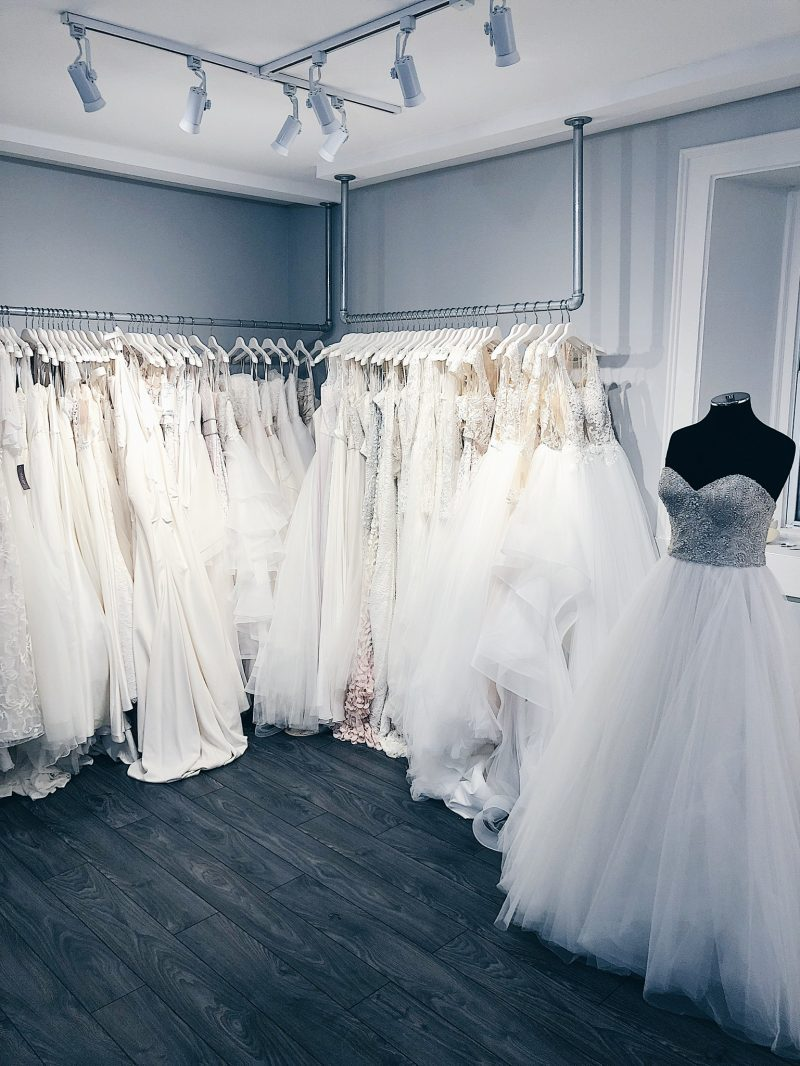 white satin bridal showroom, white satin bridal Ottawa wedding dresses on racks