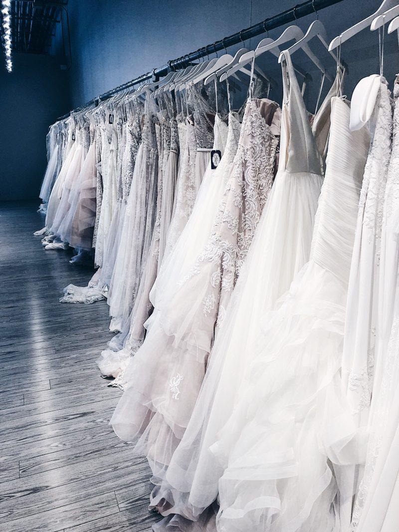 with love bridal showroom, white satin bridal Ottawa wedding dresses on racks