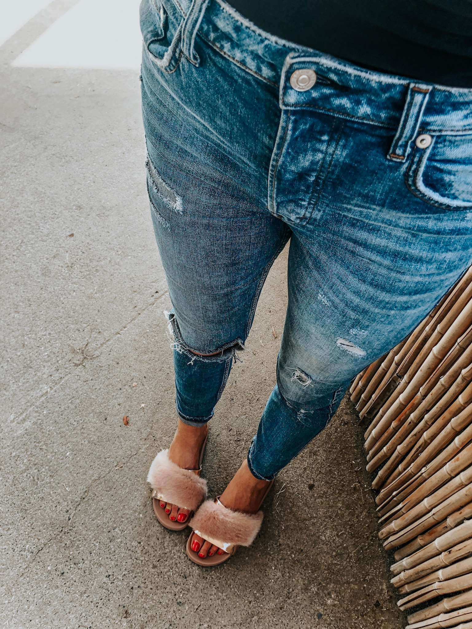 distressed jeans with fur slides