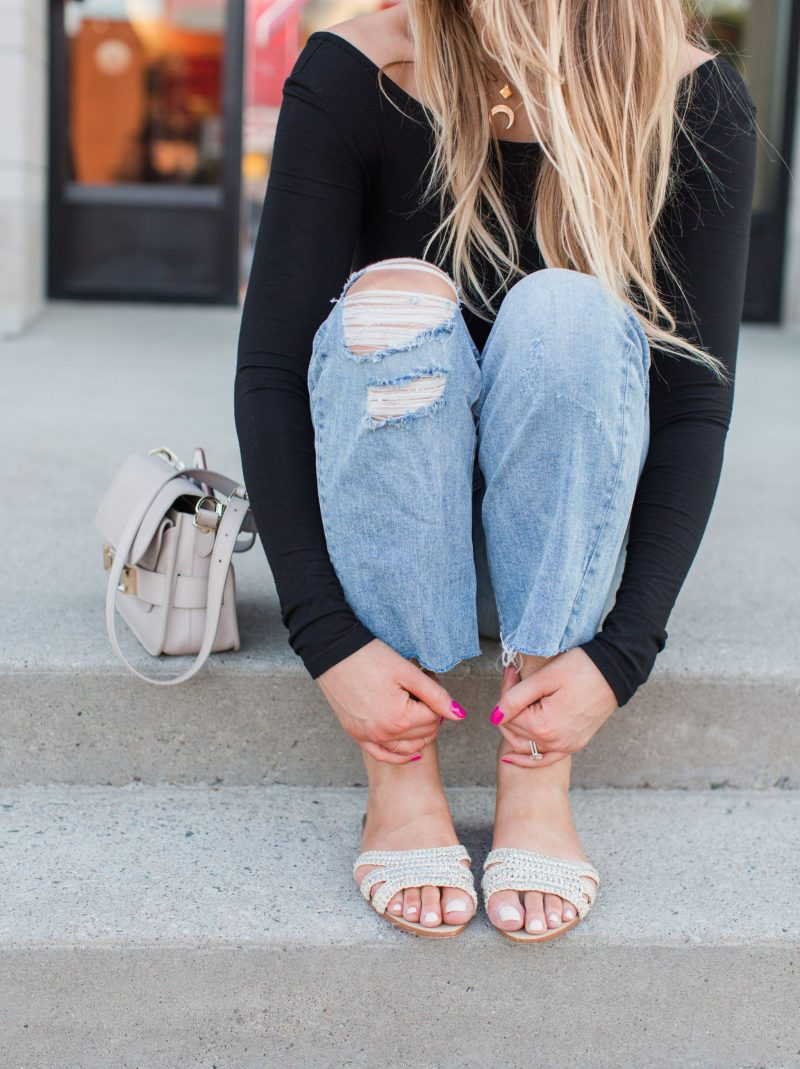 1 person, ripped mom jeans and bodysuit