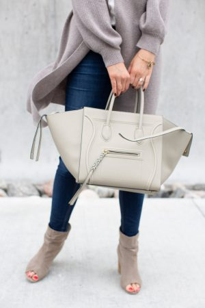 person holding Celine phantom bag with jeans
