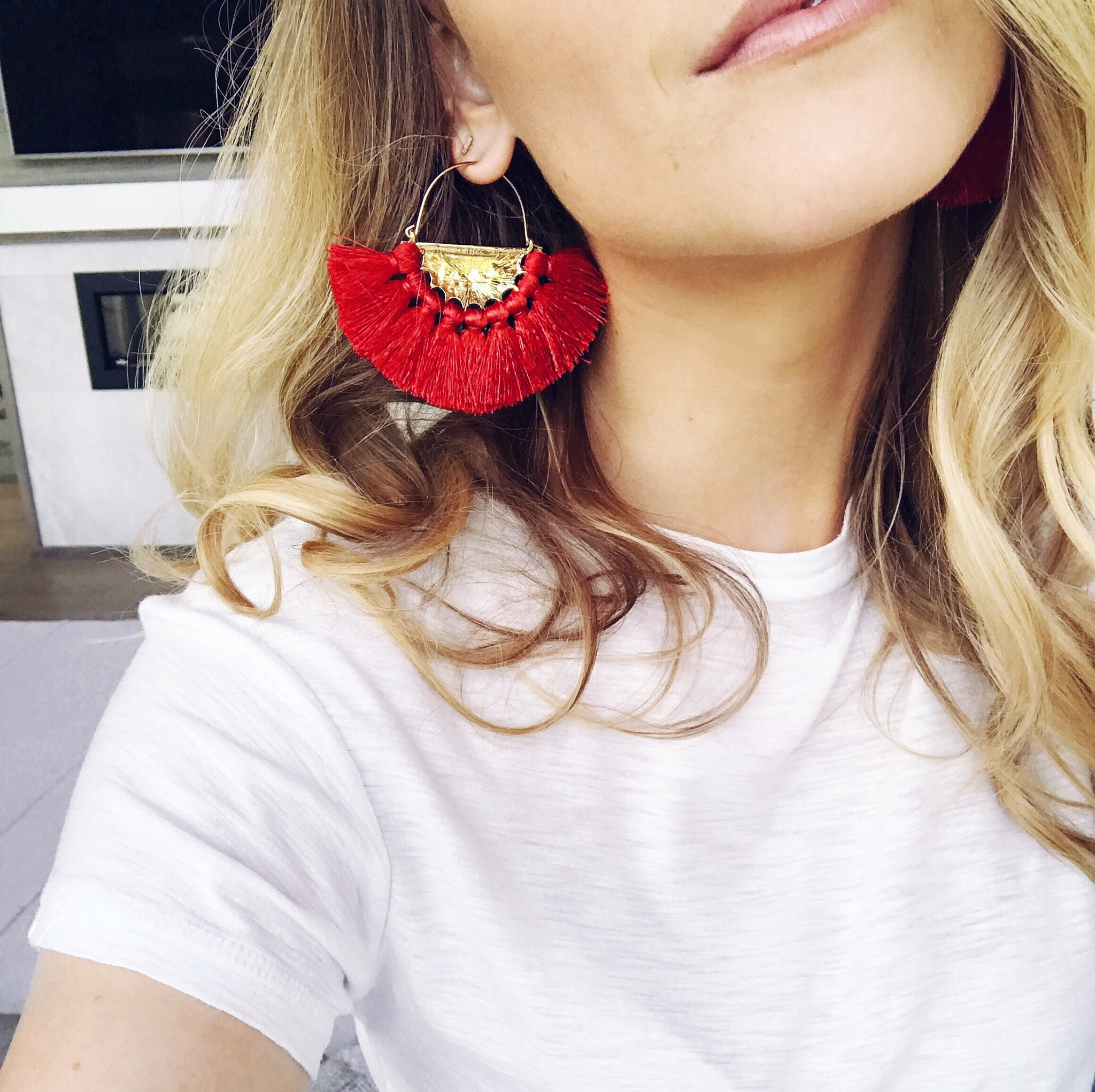 1 person selfie, red statement earrings fringe