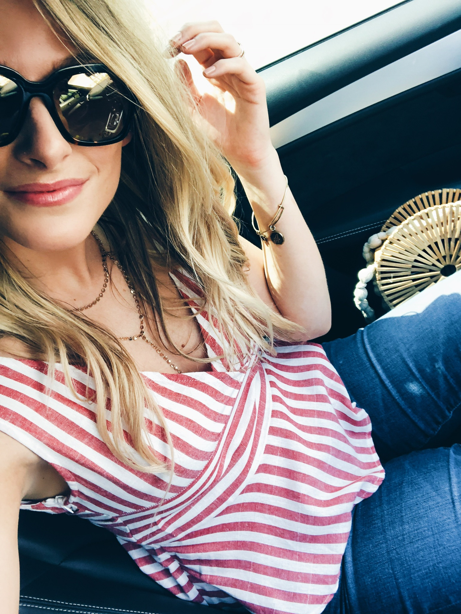 1 person, red and white striped top with jeans on girl, fashion blogger in car