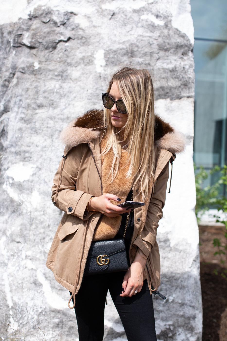 1 person, girl wearing tan coat with fur collar