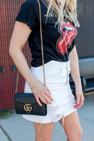 1 person, Rolling Stones tee and Gucci bag