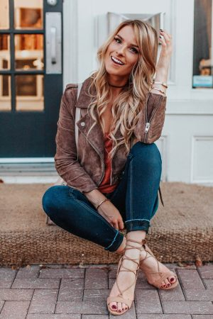 1 person, girl sitting on step in jeans and suede jacket