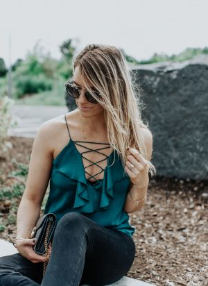 1 person, girl in lace up front top and sunglasses