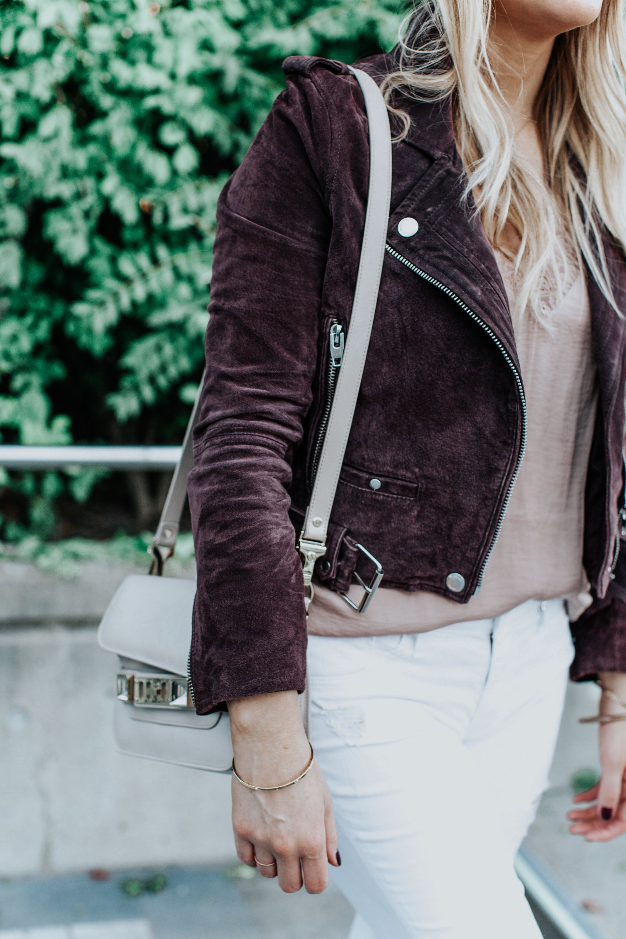 1 person, girl wearing plum suede jacket and white pants