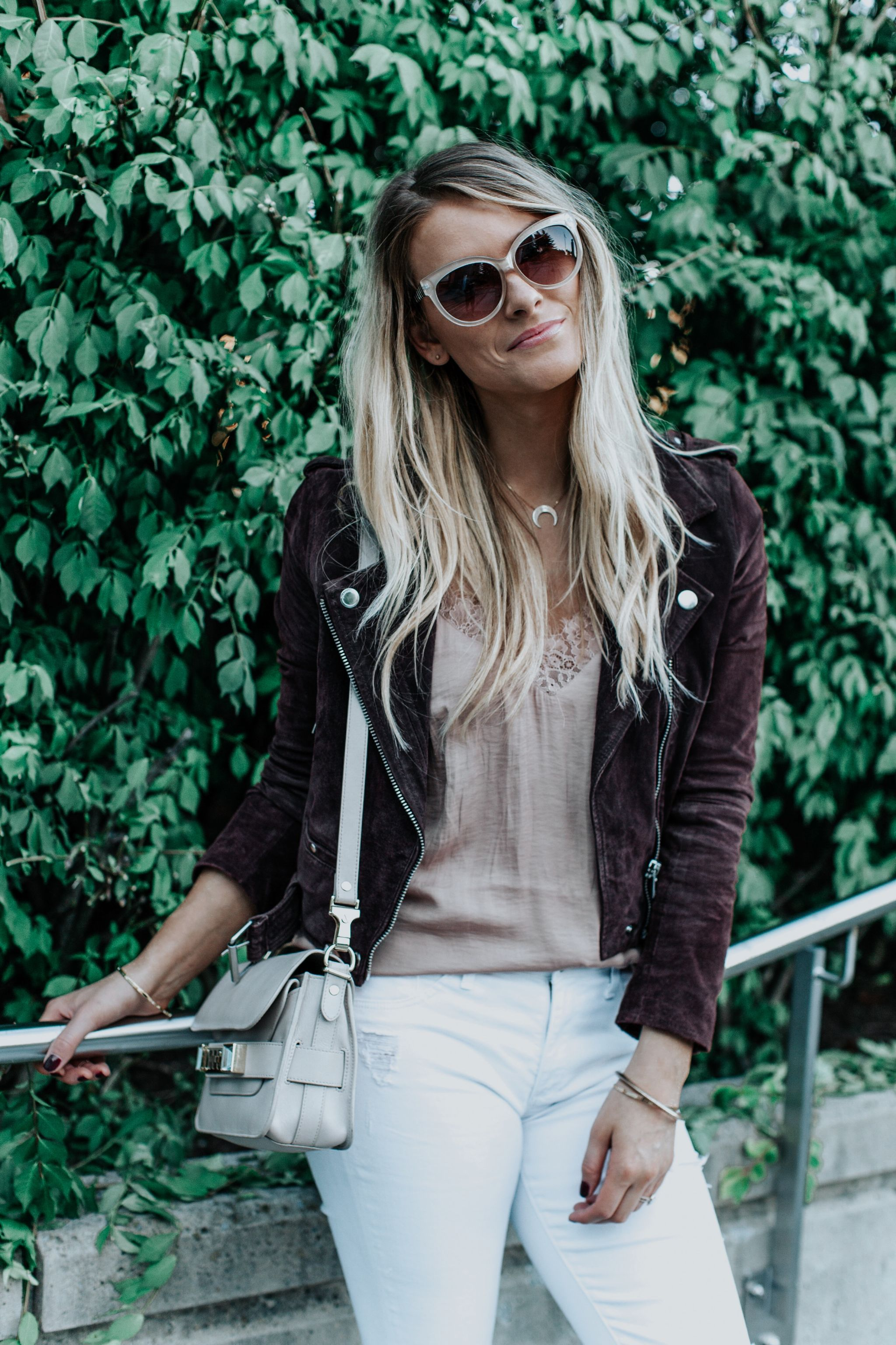 1 person, girl wearing blush cami and suede jacket