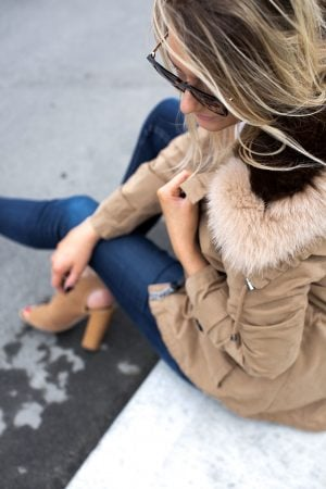 1 person, girl sitting on curb in cute fall outfit