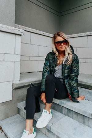 1 person, girl sitting wearing camo parka