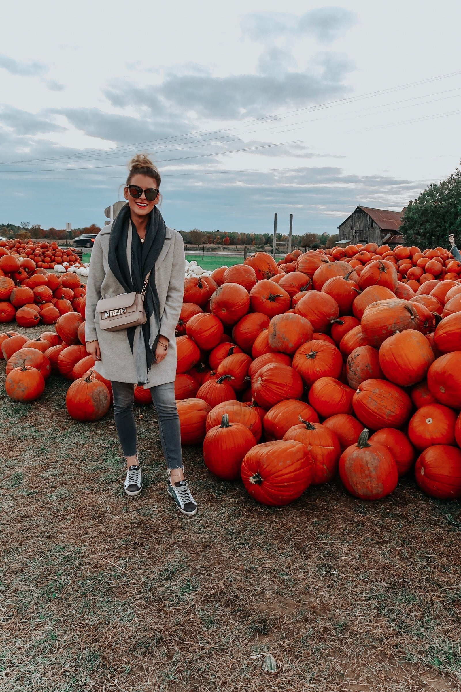 1 person, blogger at pumpkin patch in sneakers