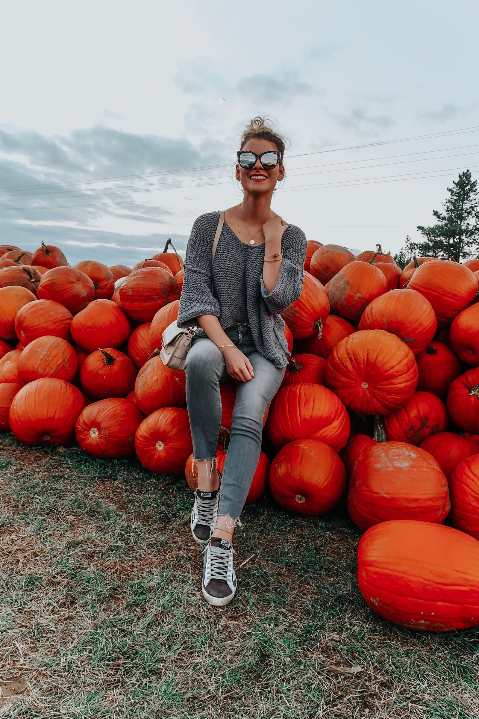 1 person girl sitting at pumpkin patch