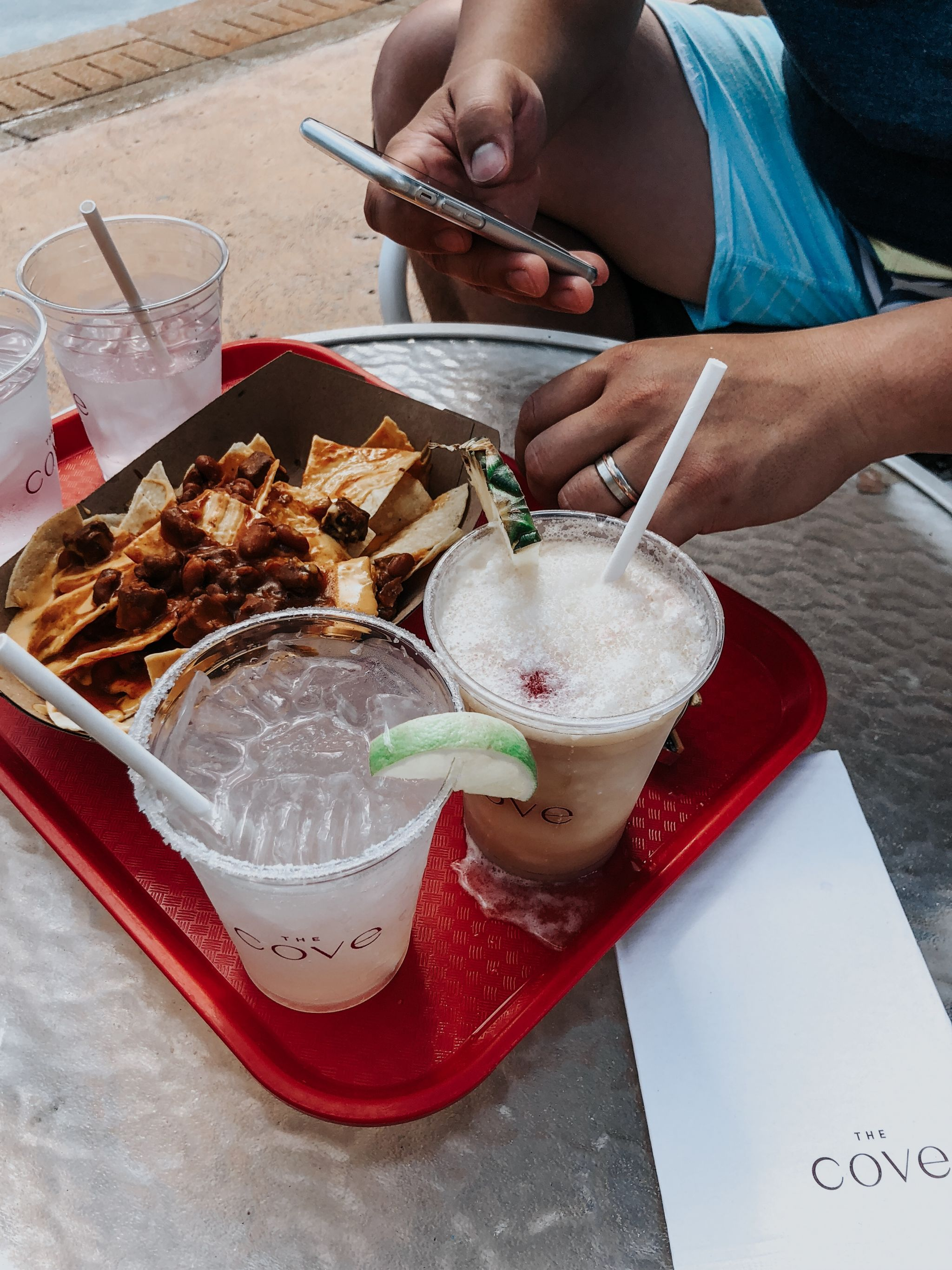 atlantis food by the pool, frozen drinks and nachos on tray