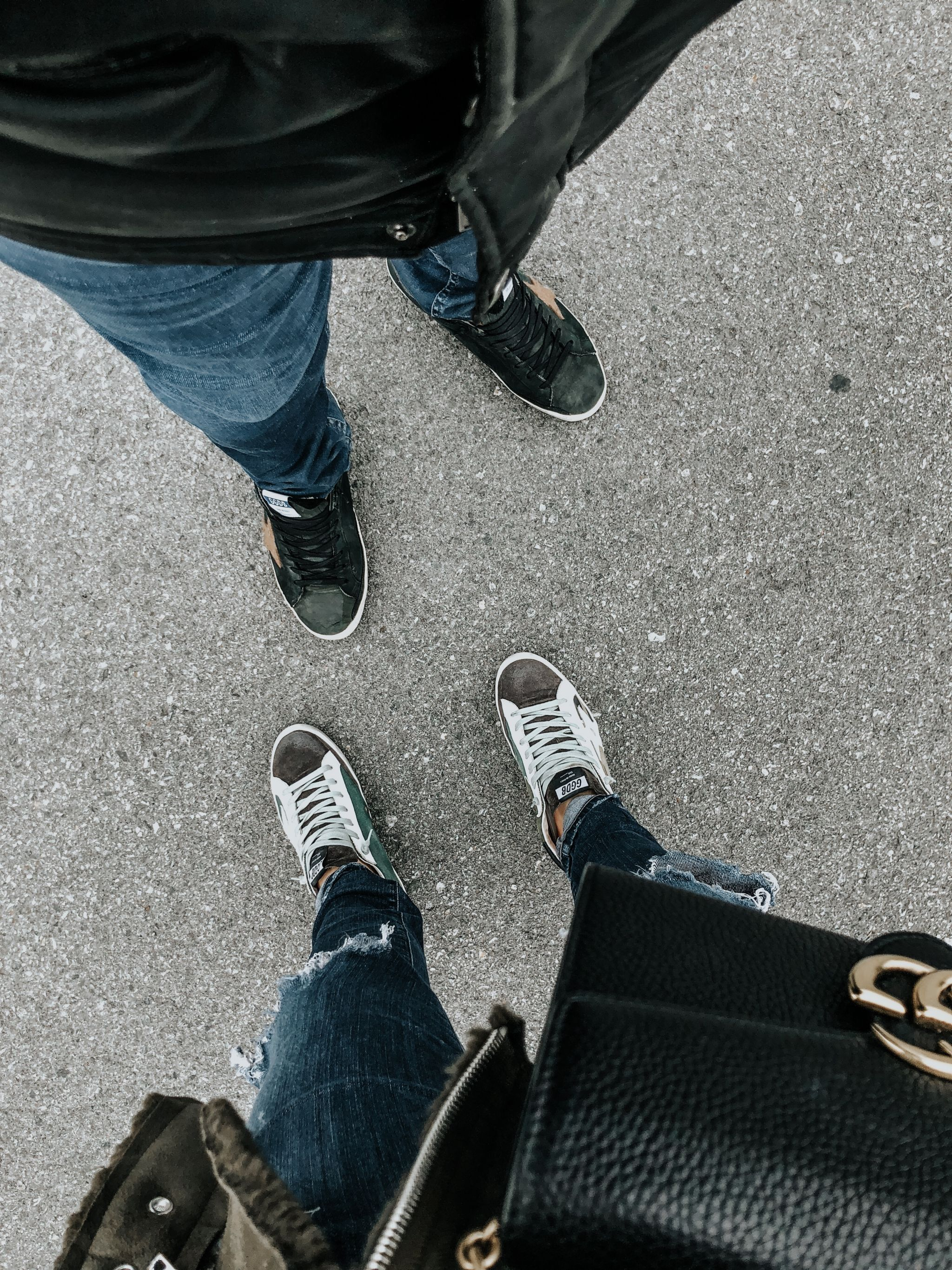 2 people, from where I stand, matching golden goose shoes