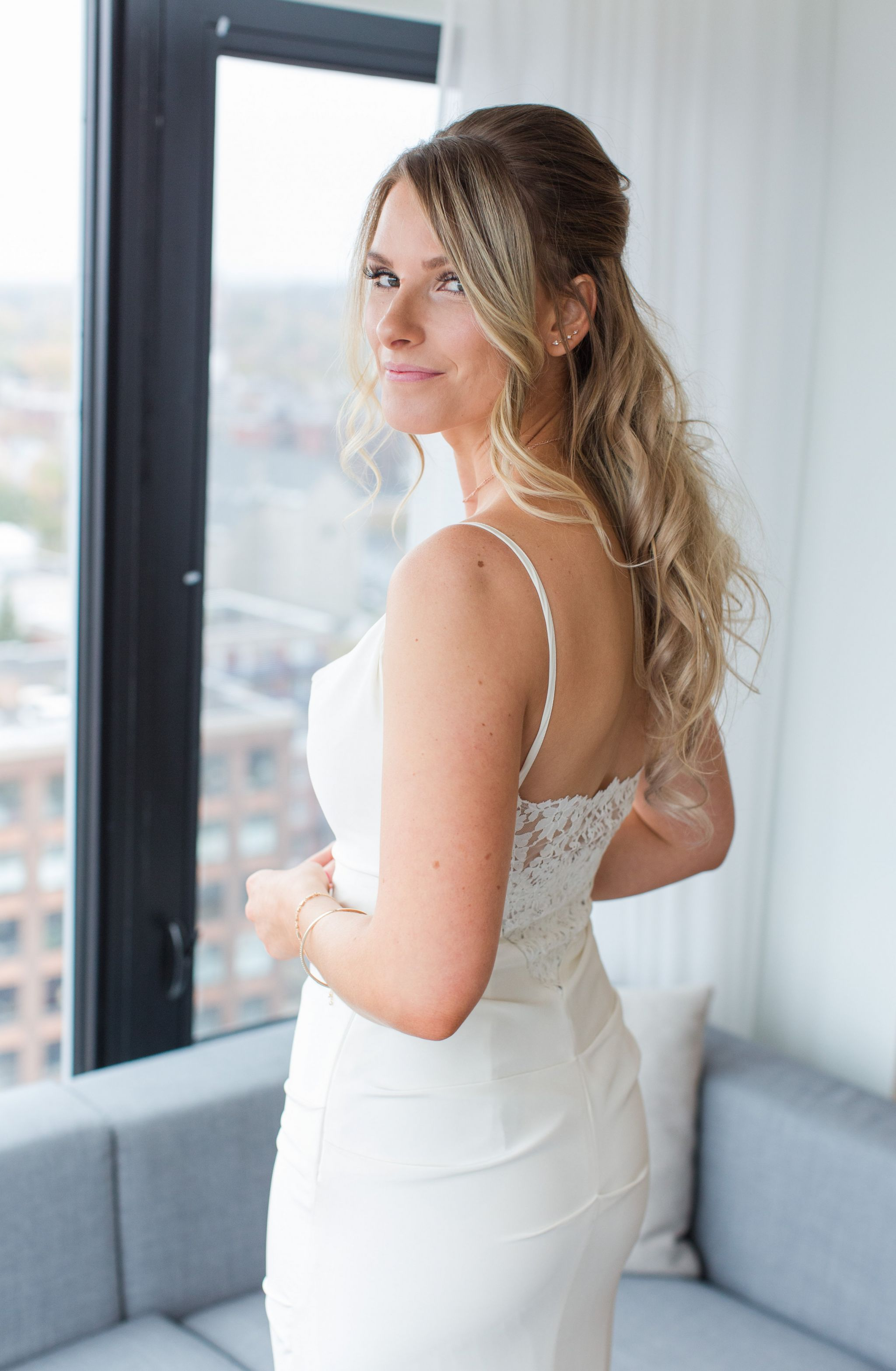 bride in lace back wedding dress, nicole miller bridal gown