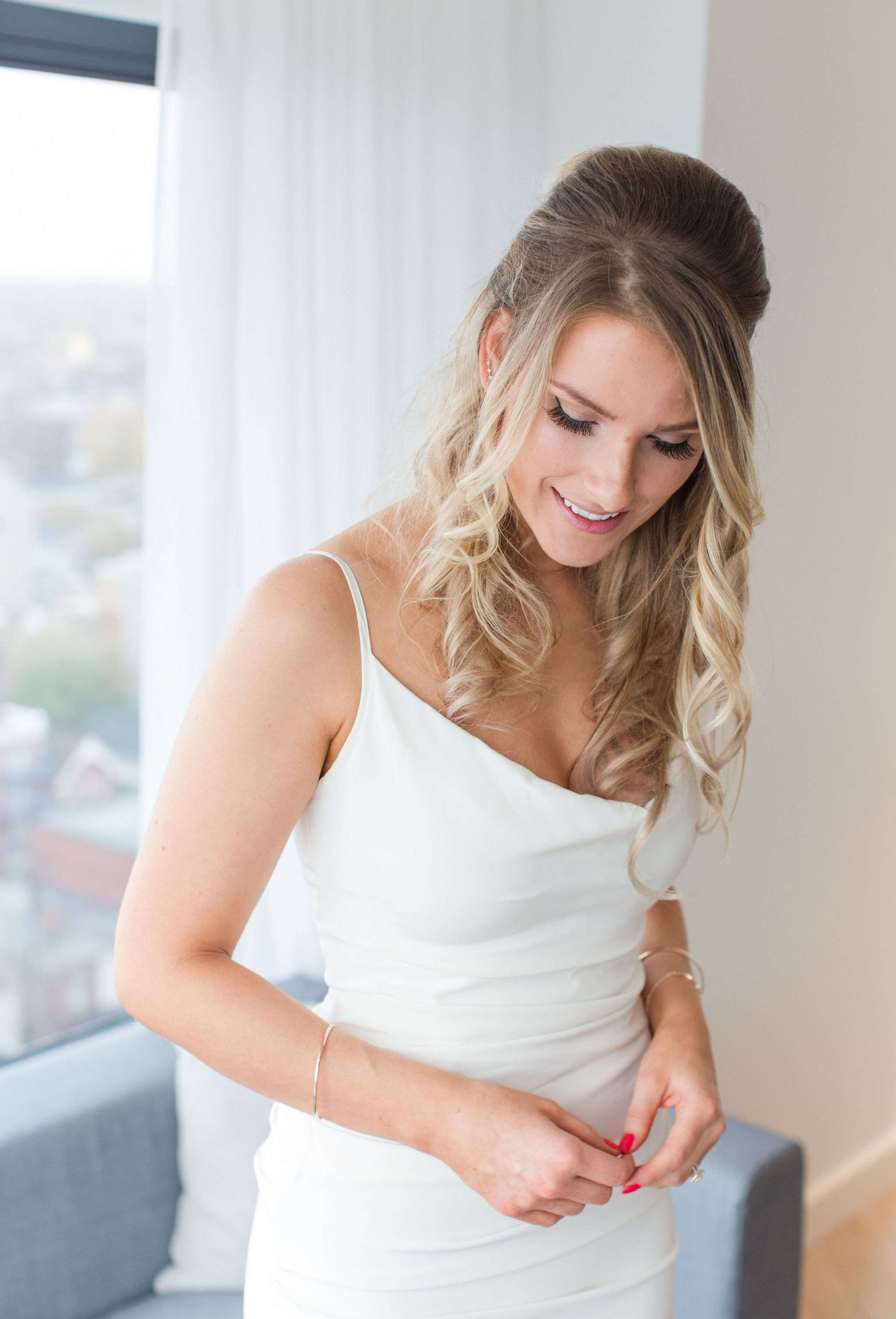 bride in cowl neck dress, nicole miller wedding dress