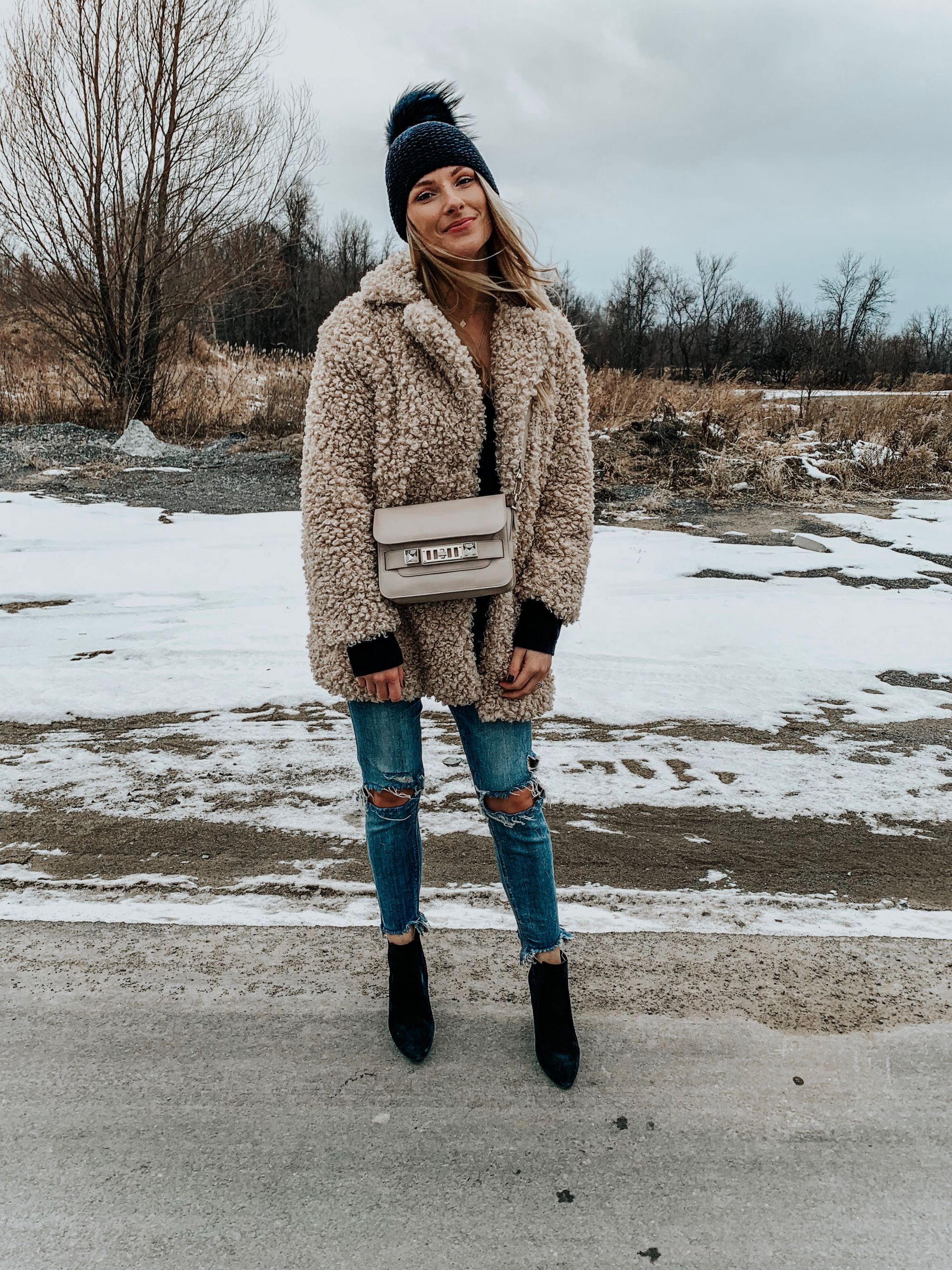 1 girl wearing teddy coat and jeans