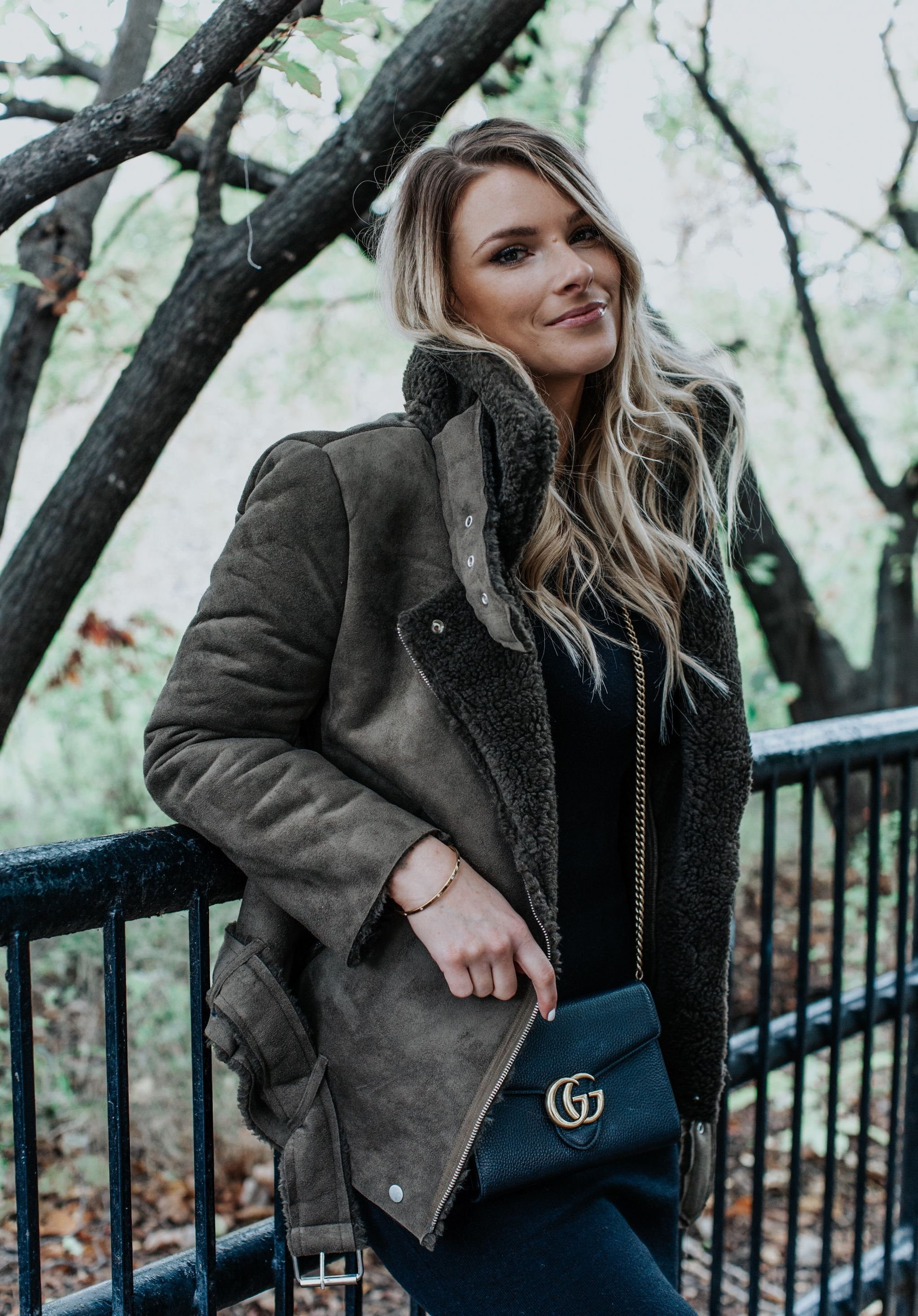 1 person, girl wearing olive green shearling jacket