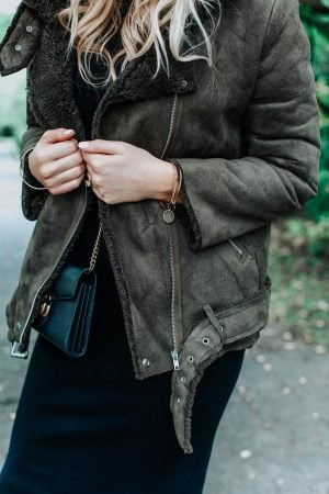 shearling jacket in green with dress, 1 person