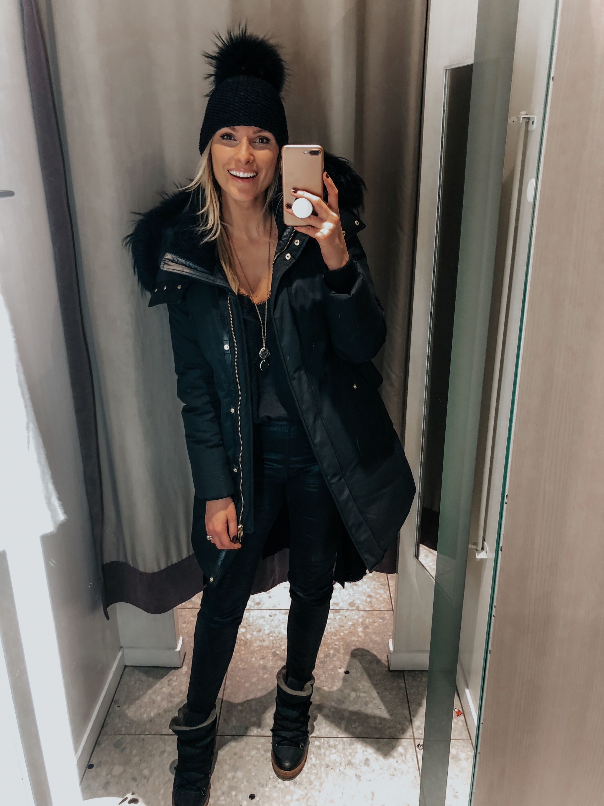 girl in fitting room, selfie, girl wearing winter jacket and hat