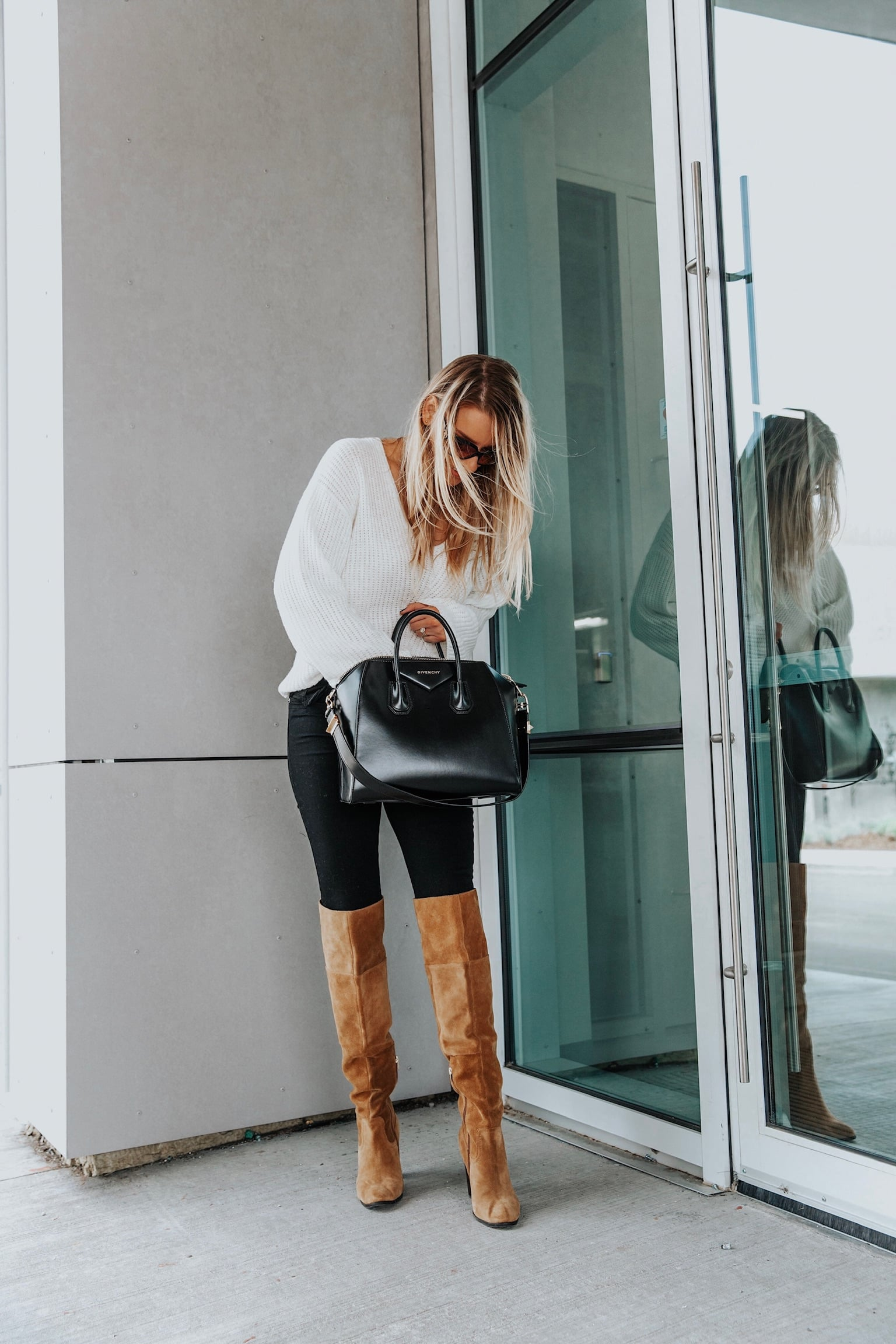 girl wearing white sweater, givenchy bag, fall outfit ideas